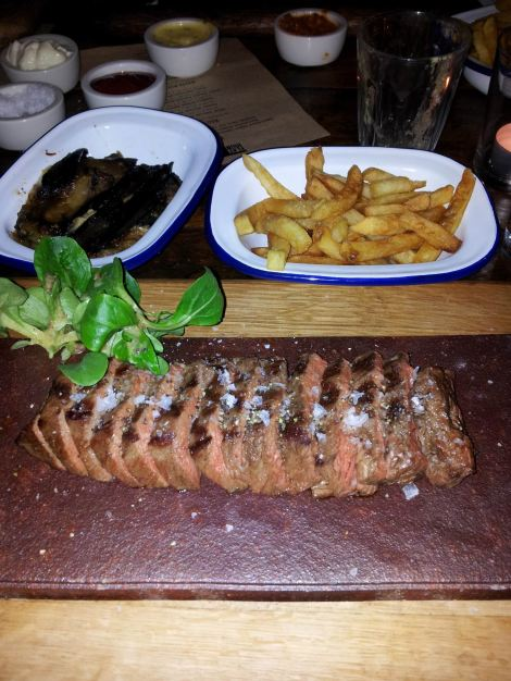 Look at those beauties - medium rare flat iron, crispy fries and aubergine bake