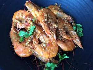 Ginataang hipon sa taba ng talangka, one of Nayna's delicious showstopper dishes. Credit to Traveling Spoon